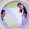 Young patient getting familiar with a SPECT-CT scanner