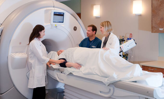Radiology staff preparing a patient for an MRI exam